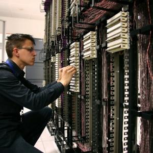 man repairing server